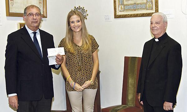 La Fallera Mayor entrega a Maides los  donativos de las fallas El acto tuvo lugar en la Basílica de la Virgen