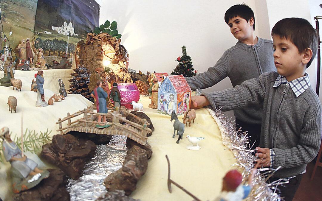 Huchas de cartón, en los belenes Recaudan fondos en Rafelbunyol para los niños sin recursos del Tercer Mundo