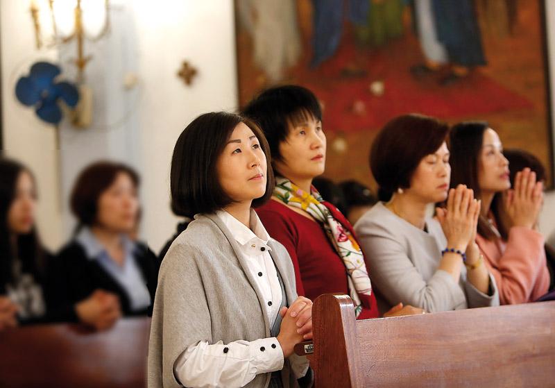Los católicos chinos en Valencia intensifican su acción evangelizadora Tras el cierre de sus bares y restaurantes por la pandemia
